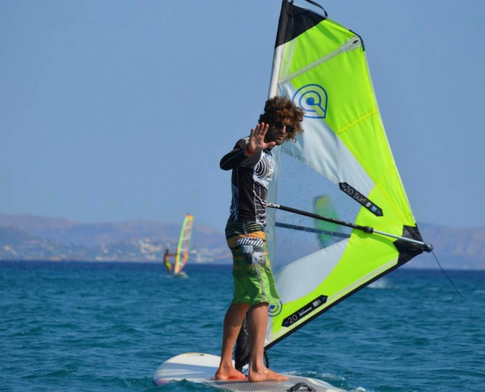 Instructor on windsurf board explaining what to do